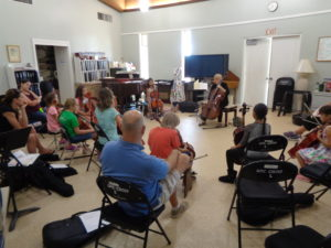 Carol Tarr lead the cello choir and repertoire classes.